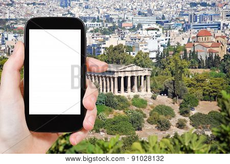 Tourist Photographs Temple Of Hephaestus In Athens