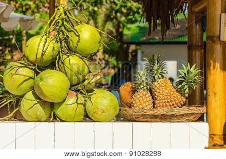 Stand with coconuts and pineapples
