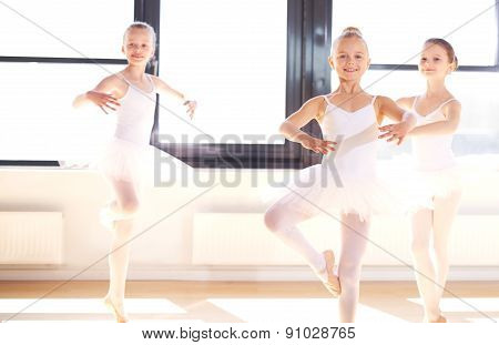 Group Of Young Ballerinas Practicing Pirouettes