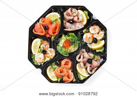 Top View Of Buffet Box Catering With Fish And Seafood