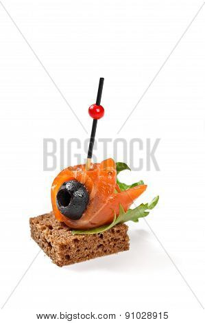 Canape With Salmon And Oliva And Bread On White Background