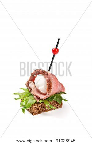 Canape With Ham Mozarella On White Background