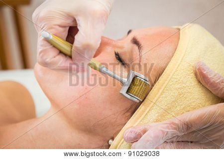 Girl with a beautician at spa salon. Beautician performs cosmetic procedures.applying cosmetic cream