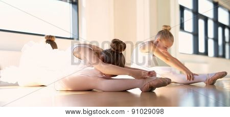 Little Ballet Girls In Stretching Warm Up Exercise