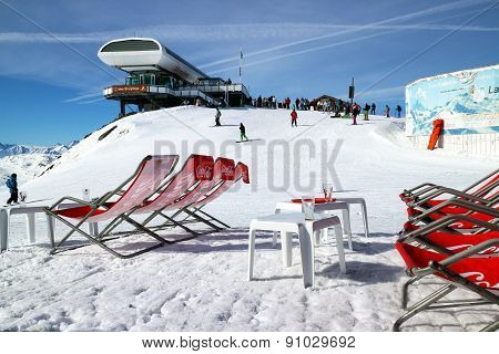 Les Menuires Alps France March 18 2014: Skiers and snowboarders on top of ski lift in Three Valleys