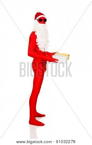 Full length santa in latex clothing holding gifts.