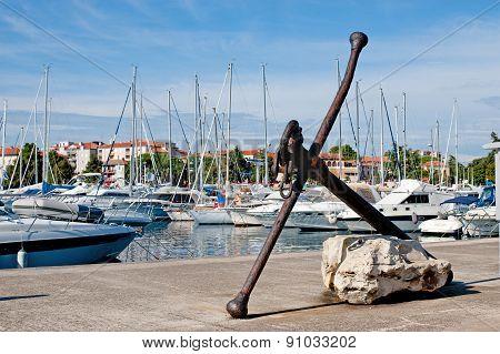 Old Anchor In The Marina Of Porec, Istria, Croatia.