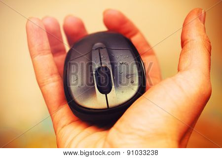 Open Hand And Computer Mouse  With Water Drops. Vintage Picture