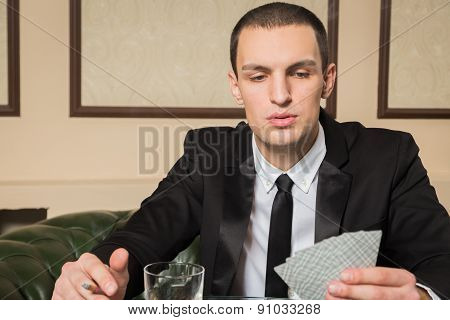 Man playing poker at the poker table