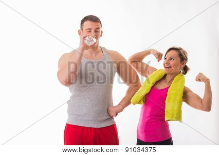 Sports man and woman posing on a white background. Athletic couple in sportswear