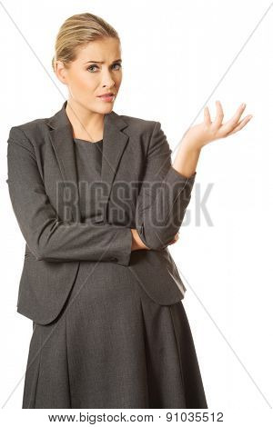 Confused woman showing irritate gesture.