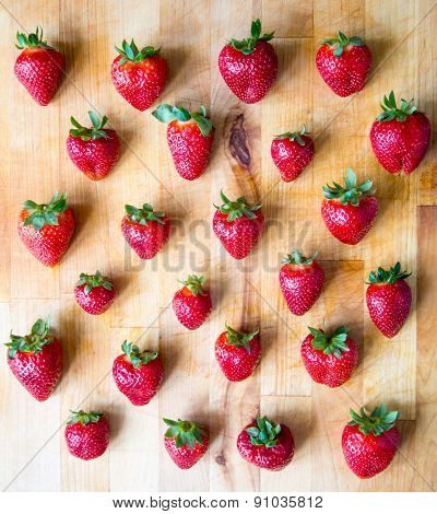 Arranged Pattern Of Strawberries On A Wooden Board