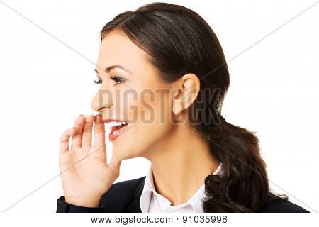 Portrait of beautiful businesswoman whispering to someone.