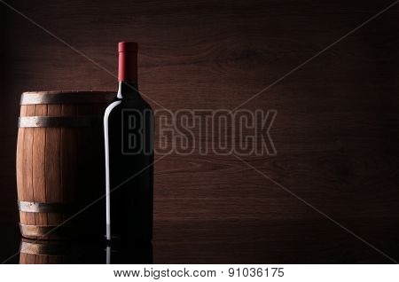 Bottle Of Red Wine And Barrel