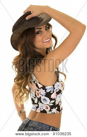 Woman In Floral Shirt Cowgirl Back Hand On Hat