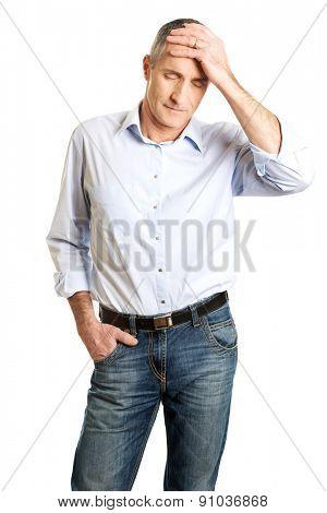 Mature man with huge headache.