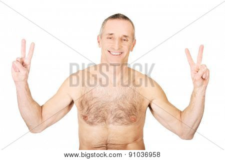 Portrait of mature shirtless man with victory sign.