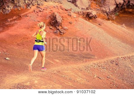 Young Woman Running In Mountains Summer Sunset