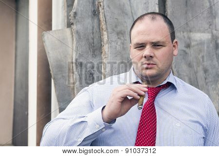 Man At Construction Site Smoking A Cigar