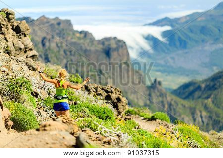 Happy Woman Running In Summer Mountains