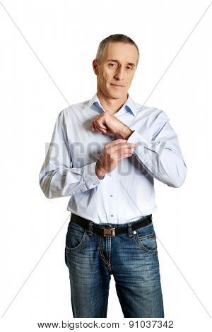 Handsome man buttoning his cuff.