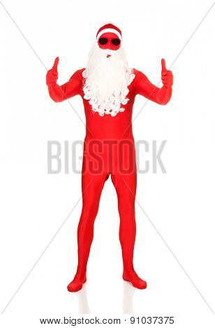 Full length santa in latex clothing with thumbs up.