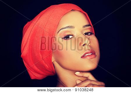 Portrait of professional black model with stage makeup.