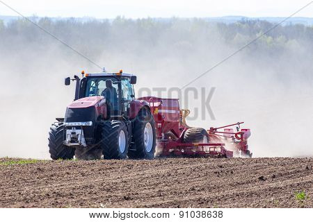 Tractor Harrowing The Field