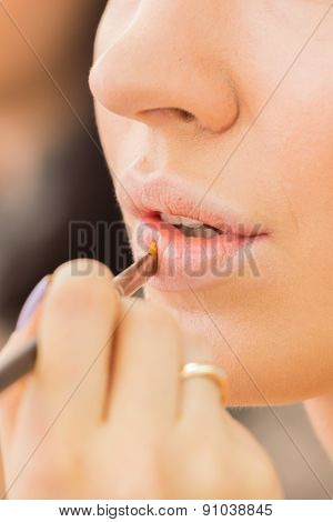 Make up process. The making of nude look for lips