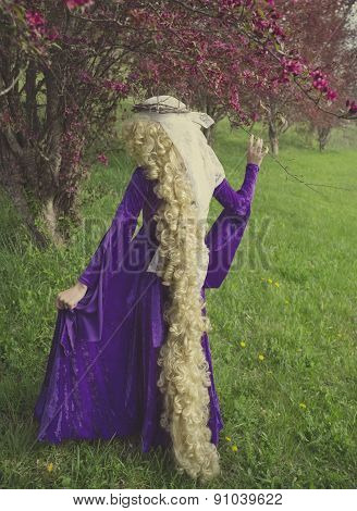 Young woman dressed as the fairy tale character Rapunzel