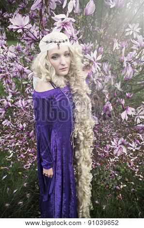 Young woman dressed as Rapunzel in purple gown
