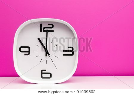 White clock on pink backgroud
