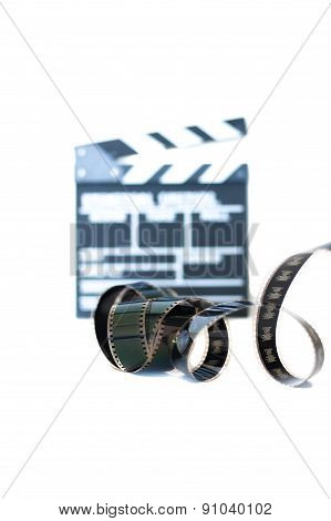 Movie Clapper And 35 Mm Filmstrip Isolated