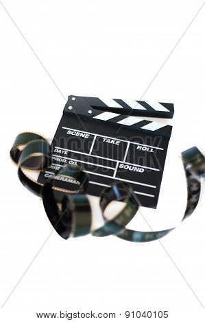 Movie Clapper And 35 Mm Filmstrip On White