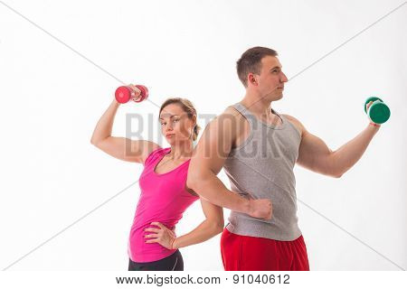 Sports man and woman posing on a white background.