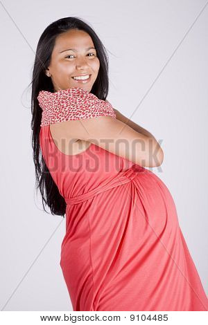 Young smiling beautiful pregnant woman in dress