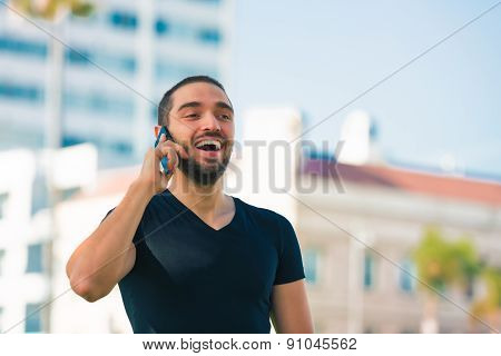 Handsome Happy And Casual Young Man With Cellphone Talking