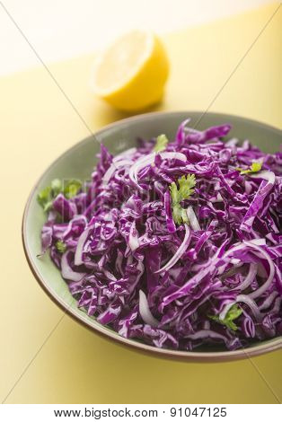 Red cabbage salad in bowl.