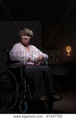 Lonely Woman Sitting On Wheelchair