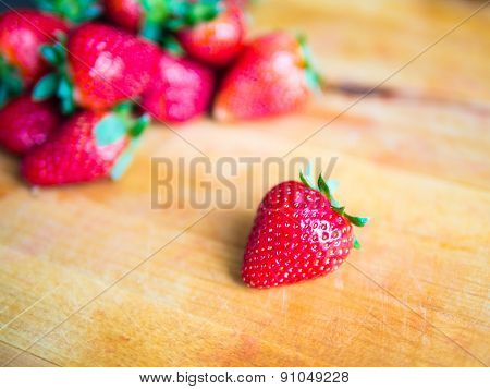 Strawberry On A Wooden Board