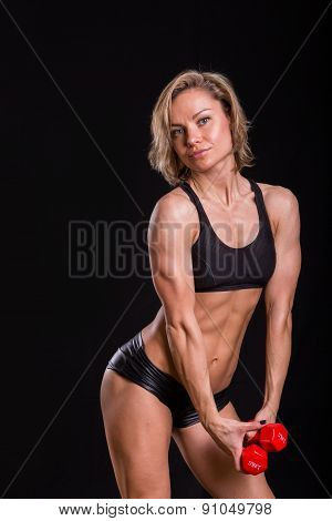 Sexy, athletic girl on a black background.