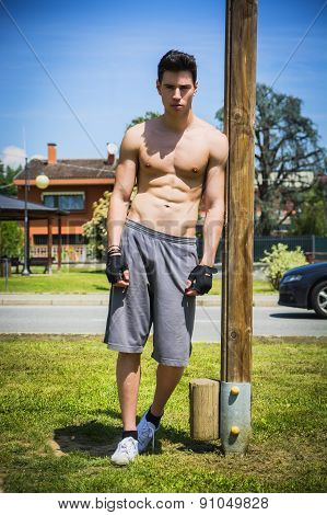 Shirtless young man resting after workout outdoor