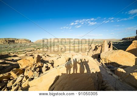 Tourist's Shadows In Chaco Culture National Historical Park, Nm, Usa