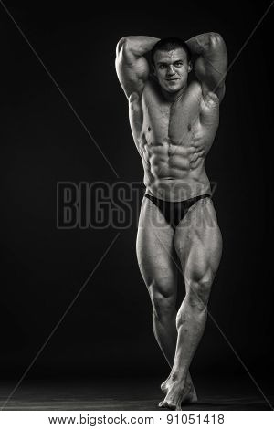 Classic bodybuilder, posing on a black background