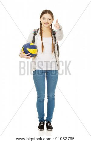 Teenager with volley ball and thumbs up.