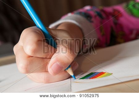 Child Drawing With Blue Pencil