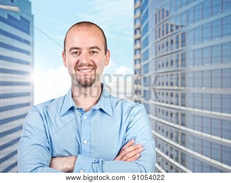 smiling businessman crossed arms