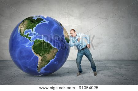 businessman try to move 3d world globe america side
