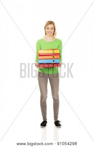 Overloaded woman with heavy binders.