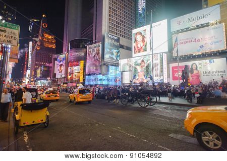 NEW YORK - SEPTEMBER 25, 2011: area around Times Square at night. Times Square is a major commercial intersection and a neighborhood in Midtown Manhattan, New York City